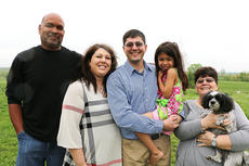"""<div class=""""source"""">Stevie Lowery</div><div class=""""image-desc"""">Pictured is Aaron Glasscock, center, with members of his family. They are, from left, his brother-in-law Johnny Yocum, his sister Jeanie Yocum, Aaron holding his niece Emma Jean and his mother Pigeon holding her dog, Bubba. </div><div class=""""buy-pic""""><a href=""""/photo_select/55318"""">Buy this photo</a></div>"""