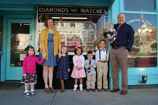 """<div class=""""source""""></div><div class=""""image-desc"""">Pictured are the proud members of the """"Payne train."""" They are, from left, 3-year-old Edyn, Mother Lucy, 5-year-old Emma, 4-year-old Kiera, 2-year-old Zalen, 6-year-old Skylar and Father Neil holding seven-month-old Noah. </div><div class=""""buy-pic""""></div>"""