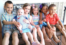 """<div class=""""source""""></div><div class=""""image-desc"""">Pictured are Neil and Lucy Payne's children. They are, from left, 6-year-old Skylar, seven-month-old Noah, 5-year-old Emma, 3-year-old Edyn, 4-year-old Kiera, and 2-year-old Zalen. </div><div class=""""buy-pic""""></div>"""