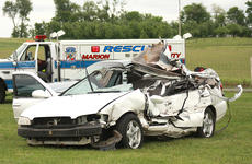 """<div class=""""source"""">Stephen Lega</div><div class=""""image-desc"""">The Nissan Altima involved in the collision came to rest several yard away from Campbellsville Highway.</div><div class=""""buy-pic""""></div>"""