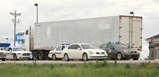 """<div class=""""source"""">Stephen Lega</div><div class=""""image-desc"""">Police vehicles remained around the semi truck, which remained on Campbellsville Highway near the traffic light before the entrance to Wal-mart.</div><div class=""""buy-pic""""></div>"""