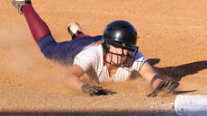 """<div class=""""source"""">Nick Schrager</div><div class=""""image-desc"""">With dirt and sand flying, junior shortstop Taylor Wade dives into third base.</div><div class=""""buy-pic""""><a href=""""/photo_select/34432"""">Buy this photo</a></div>"""