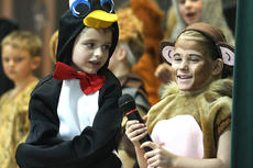 """<div class=""""source"""">Stevie Lowery</div><div class=""""image-desc"""">Tye Farmer, a penguin, and Jazmine Hourigan, a monkey, sing a song together. </div><div class=""""buy-pic""""><a href=""""/photo_select/27248"""">Buy this photo</a></div>"""