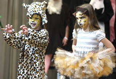 """<div class=""""source"""">Stevie Lowery</div><div class=""""image-desc"""">A ferocious leopard, Marissa McCubbin, and a lovely lion, Addison Milby, perform on stage together. </div><div class=""""buy-pic""""><a href=""""/photo_select/27250"""">Buy this photo</a></div>"""