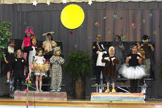 """<div class=""""source"""">Stevie Lowery</div><div class=""""image-desc"""">Pictured is some of the """"Wild Things"""" cast. They are, front row from left, Rayelyn Dozier, Addison Milby, Mason Turner and Maddie McDonald; middle row from left, Will Blake, Ty Farmer, Vanessa VanWhy, Linsey Craig and Jazmine Hourigan; back row from left, Jenna Bland, Madison Lee, Jackson Willet, Candace Colvin and Caden Chesser. </div><div class=""""buy-pic""""><a href=""""/photo_select/27252"""">Buy this photo</a></div>"""