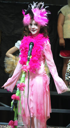 """<div class=""""source"""">Stevie Lowery</div><div class=""""image-desc"""">Jenna Bland is pretty in pink as a flamingo. </div><div class=""""buy-pic""""><a href=""""/photo_select/27256"""">Buy this photo</a></div>"""