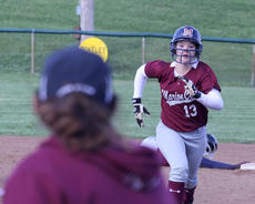 """<div class=""""source"""">Nick Schrager</div><div class=""""image-desc"""">Freshman first baseman Kendall Benningfield retreats back to first base as assistant coach Laura Mattingly watches during last week's game at Washington County. </div><div class=""""buy-pic""""><a href=""""/photo_select/34539"""">Buy this photo</a></div>"""