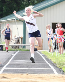 "<div class=""source"">Nick Schrager</div><div class=""image-desc"">Miranda Bradshaw makes a flying leap in the regional track meet. She'll be competing in the Class AA state meet on Friday.</div><div class=""buy-pic""><a href=""http://web2.lcni5.com/cgi-bin/c2newbuyphoto.cgi?pub=015&orig=05-21-14_track_pic_3.jpg"" target=""_new"">Buy this photo</a></div>"