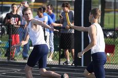 "<div class=""source"">Nick Schrager</div><div class=""image-desc"">Justin Overstreet reaches for handoff from Taylor Lanham during the May 13 regional track meet. </div><div class=""buy-pic""><a href=""http://web2.lcni5.com/cgi-bin/c2newbuyphoto.cgi?pub=015&orig=05-21-14_track_pic_5.jpg"" target=""_new"">Buy this photo</a></div>"