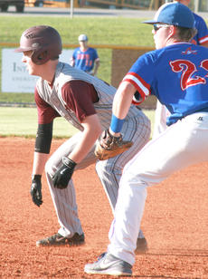 """<div class=""""source"""">Casey Sowers</div><div class=""""image-desc"""">Robbie Spalding takes a lead at first base in last week's district tournament game against Adair County. </div><div class=""""buy-pic""""><a href=""""/photo_select/42096"""">Buy this photo</a></div>"""