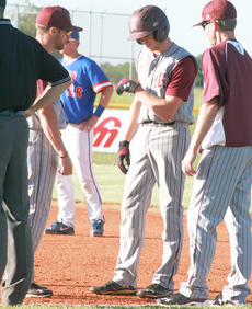 """<div class=""""source"""">Casey Sowers</div><div class=""""image-desc"""">Jeremy Morris talks with coaches at first base after being hit with the ball against Adair County in the 20th District tournament.</div><div class=""""buy-pic""""><a href=""""/photo_select/42098"""">Buy this photo</a></div>"""