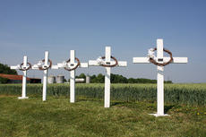"<div class=""source"">Stevie Lowery</div><div class=""image-desc"">Five concrete crosses are located on Highway 49 in Loretto where the crash occurred. Family members of each of the young men who were killed placed a wreath on a cross during the prayer service.</div><div class=""buy-pic""><a href=""http://web2.lcni5.com/cgi-bin/c2newbuyphoto.cgi?pub=015&orig=05-28-14_50_year_wreck_anniv_pic_5.jpg"" target=""_new"">Buy this photo</a></div>"