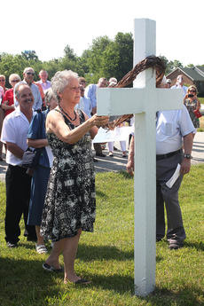 "<div class=""source"">Stevie Lowery</div><div class=""image-desc"">Gail Ballard Taylor, Stanley Ballard's younger sister, places a wreath on his cross. He was one of the five young men killed in the car wreck.</div><div class=""buy-pic""><a href=""http://web2.lcni5.com/cgi-bin/c2newbuyphoto.cgi?pub=015&orig=05-28-14_50_year_wreck_anniv_pic_9.jpg"" target=""_new"">Buy this photo</a></div>"