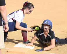 """<div class=""""source"""">Nick Schrager</div><div class=""""image-desc"""">Freshman first baseman Kendall Benningfield kneels in attempt to tag out Lady Indians senior outfielder Natalie Bertram during the district tournament.</div><div class=""""buy-pic""""><a href=""""/photo_select/34697"""">Buy this photo</a></div>"""