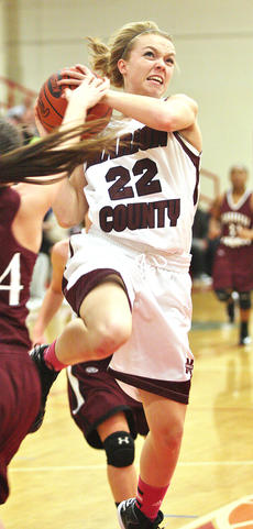 "<div class=""source"">Jessica Veatch</div><div class=""image-desc"">Junior Colleen Rakes gets fouled after stealing the basketball and going in for a shot in the 67-40 win over Henderson County in the Duke's Sporting Goods Valentine's Day Shootout. </div><div class=""buy-pic""><a href=""/photo_select/25410"">Buy this photo</a></div>"
