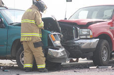 """<div class=""""source"""">Photo by Stephen Lega</div><div class=""""image-desc"""">Lebanon Firefighter Travis Garrett examines the scene after an accident June 3 at the intersection of Campbellsville Highway and the Marion County Veterans Memorial Highway.</div><div class=""""buy-pic""""><a href=""""/photo_select/12446"""">Buy this photo</a></div>"""
