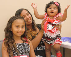 """<div class=""""source"""">Stephen Lega</div><div class=""""image-desc"""">Mariona Avendano, 10 months, cheers as her mother, Leondra Avendano holds her, and her sister, Marisela Avendano, 7, waits to participate in the beauty contest Friday at Old Mill Days. </div><div class=""""buy-pic""""><a href=""""/photo_select/35300"""">Buy this photo</a></div>"""