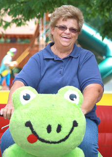 """<div class=""""source"""">Stephen Lega</div><div class=""""image-desc"""">Sue Benningfield proves you don't have to be a kid to enjoy the Zippy Land rides. </div><div class=""""buy-pic""""><a href=""""/photo_select/35301"""">Buy this photo</a></div>"""