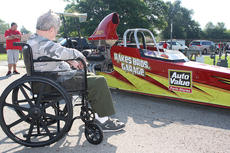 "<div class=""source"">Stevie Lowery</div><div class=""image-desc"">Pictured is Joseph ""Tony"" Cissell, one of the residents, checking out Peterson's racecar. </div><div class=""buy-pic""><a href=""/photo_select/35397"">Buy this photo</a></div>"