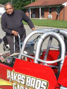 "<div class=""source"">Stevie Lowery</div><div class=""image-desc"">Mary Rose Downs inspects the racecar for herself.</div><div class=""buy-pic""><a href=""/photo_select/35399"">Buy this photo</a></div>"