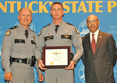 """<div class=""""source"""">Photo submitted</div><div class=""""image-desc"""">Kentucky State Trooper Toby E. Young (center) recently received the Kentucky State Police Special Operations Branch Trooper of the Year Award from KSP Commissioner Rodney Brewer (left) and Justice and Public Safety Cabinet Secretary J. Michael Brown (right) in Frankfort. Young is a 12-year veteran of the agency. He is the son of former Lebanon Police Chief Shelton Young.</div><div class=""""buy-pic""""></div>"""