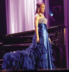 """<div class=""""source"""">Trena Spalding/The Digital Touch</div><div class=""""image-desc"""">Christine Mattingly looks out at the crowd after performing her talent, which was the same piano piece she played in the local and state competitions, Impromptu in C Sharp Minor by Hugo Reinhold. </div><div class=""""buy-pic""""></div>"""