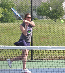 """<div class=""""source"""">Jessica Veatch</div><div class=""""image-desc"""">Senior Madison Cassidy returns a shot at the regional tennis tournament at Freeman Lake Courts in Elizabethtown. Cassidy and doubles partner Elyssa Holt were regional semifinalists and will compete in the state tennis tournament tomorrow.</div><div class=""""buy-pic""""><a href=""""/photo_select/27239"""">Buy this photo</a></div>"""