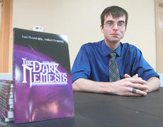 "<div class=""source"">Photo by Stephen Lega</div><div class=""image-desc"">Nathaniel Weathers held a book-signing June 28 at the Knights of Columbus Hall in Lebanon for the release of the second edition of his book, The Dark Nemesis, which is part of a his The Destiny of the Lords of Power series. Weathers also showed a short film based on the first part of his book. Copies of the book can be purchased online at www.tatepublishing.com. For more information about Weathers, visit his Facebook page, www.facebook.com/thewritingideal.