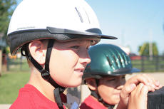 """<div class=""""source"""">Stephen Lega</div><div class=""""image-desc"""">Logan Peterson, 11, of Calvary and Vincente Venegas, 11, of Lebanon wait for their turn to ride horses.</div><div class=""""buy-pic""""><a href=""""/photo_select/13074"""">Buy this photo</a></div>"""
