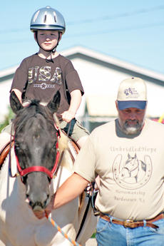 """<div class=""""source"""">Stephen Lega</div><div class=""""image-desc"""">Merrick Turner, 10, of Campbellsville rides Poco. Todd Simpson of Gravel Switch walks beside the horse.</div><div class=""""buy-pic""""><a href=""""/photo_select/13070"""">Buy this photo</a></div>"""