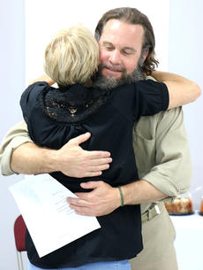 """<div class=""""source"""">Stevie Lowery</div><div class=""""image-desc"""">Gerard Foote hugs his mother after being recognized for his completion of the R.E.A.C.H. Program at the Marion County Detention Center. </div><div class=""""buy-pic""""><a href=""""/photo_select/56470"""">Buy this photo</a></div>"""