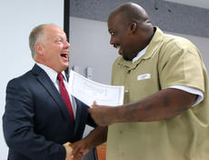 """<div class=""""source"""">Stevie Lowery</div><div class=""""image-desc"""">Marion County Jailer Barry Brady congratulates Jeremy Standard for his completion of the R.E.A.C.H. Program. </div><div class=""""buy-pic""""><a href=""""/photo_select/56471"""">Buy this photo</a></div>"""