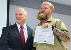"""<div class=""""source"""">Stevie Lowery</div><div class=""""image-desc"""">Dustin Johnson and Marion County Jailer Barry Brady pose for a photo at the R.E.A.C.H. Program ceremony Friday morning. </div><div class=""""buy-pic""""><a href=""""/photo_select/56472"""">Buy this photo</a></div>"""
