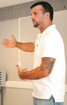 """<div class=""""source"""">Stevie Lowery</div><div class=""""image-desc"""">Kenneth Eldridge, a former inmate at the Marion County Detention Center, speaks about his time in jail and how it's helped him outside in the real world. At the age of 23, he was sentenced to 19 years in prison for trafficking heroin. The programs at MCDC, along with his faith, are what helped him make a change in his life. """"It was the resources here that really got me on board to keep on going,"""" he said.</div><div class=""""buy-pic""""><a href=""""/photo_select/56476"""">Buy this photo</a></div>"""