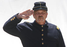 "<div class=""source"">Stephen Lega</div><div class=""image-desc"">Tom Bottoms, dressed in a Union uniform, salutes during the playing of the Star-Spangled Banner, which was a popular song during the Civil War, but did not become the national anthem officially until 1931.</div><div class=""buy-pic""><a href=""/photo_select/28542"">Buy this photo</a></div>"