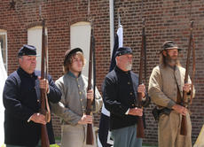 "<div class=""source"">Stephen Lega</div><div class=""image-desc"">Civil War re-enactors representing the Union and the Confederacy stand at attention during the national anthem. They camped on either side of the heritage center over the weekend. They are, from left, Robert Spegal, John Roution Jr., John Hill, and John Routin Sr.</div><div class=""buy-pic""><a href=""/photo_select/28543"">Buy this photo</a></div>"