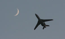 """<div class=""""source"""">Stephen Lega</div><div class=""""image-desc"""">As the sun was setting Friday evening, Ali Machinky's Falcon 7-X model passes by the moon, which was visible in the twilight sky. Machinchy is from England. </div><div class=""""buy-pic""""><a href=""""/photo_select/28529"""">Buy this photo</a></div>"""