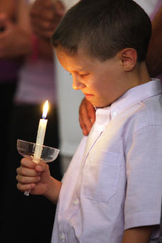 "<div class=""source"">Stevie Lowery</div><div class=""image-desc"">Austin Tingle, 8, holds a candle and closes his eyes in prayer during a special candlelight vigil for his mother, Kara Tingle Rigdon, who has been missing since July 17, 2010.</div><div class=""buy-pic""><a href=""http://web2.lcni5.com/cgi-bin/c2newbuyphoto.cgi?pub=015&orig=07-20-11%2Bkara%2Brigdon%2Baustin%2Bpraying.jpg"" target=""_new"">Buy this photo</a></div>"