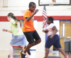 """<div class=""""source"""">Stevie Lowery</div><div class=""""image-desc"""">Javon Adams shows off his speed during a running exercise. </div><div class=""""buy-pic""""><a href=""""http://web2.lcni5.com/cgi-bin/c2newbuyphoto.cgi?pub=015&orig=07-23-14_ges_summer_camp_10.jpg"""" target=""""_new"""">Buy this photo</a></div>"""