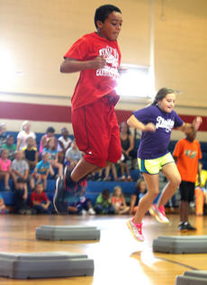 """<div class=""""source"""">Stevie Lowery</div><div class=""""image-desc"""">Omarrion Bunch prepares to land after jumping high over a """"fitness box.""""</div><div class=""""buy-pic""""><a href=""""http://web2.lcni5.com/cgi-bin/c2newbuyphoto.cgi?pub=015&orig=07-23-14_ges_summer_camp_11.jpg"""" target=""""_new"""">Buy this photo</a></div>"""