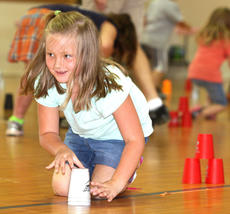 """<div class=""""source"""">Stevie Lowery</div><div class=""""image-desc"""">Madison Sapp eyes the competition while participating in a cup stacking competition. </div><div class=""""buy-pic""""><a href=""""http://web2.lcni5.com/cgi-bin/c2newbuyphoto.cgi?pub=015&orig=07-23-14_ges_summer_camp_3_0.jpg"""" target=""""_new"""">Buy this photo</a></div>"""