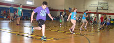 """<div class=""""source"""">Stevie Lowery</div><div class=""""image-desc"""">From left, Gavin Spalding, Haley Lewis, Makenna Wheatley, Caitlynn Brady, Terrence Flowers, Brady Elder, Aiden Phillips and India Young concentrate on their footing during a physical education exercise. </div><div class=""""buy-pic""""><a href=""""http://web2.lcni5.com/cgi-bin/c2newbuyphoto.cgi?pub=015&orig=07-23-14_ges_summer_camp_5_0.jpg"""" target=""""_new"""">Buy this photo</a></div>"""