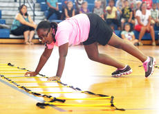 """<div class=""""source"""">Stevie Lowery</div><div class=""""image-desc"""">Tyra Belle concentrates on her coordination during a physical education exercise. </div><div class=""""buy-pic""""><a href=""""http://web2.lcni5.com/cgi-bin/c2newbuyphoto.cgi?pub=015&orig=07-23-14_ges_summer_camp_8_0.jpg"""" target=""""_new"""">Buy this photo</a></div>"""