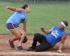 """<div class=""""source"""">Nick Schrager</div><div class=""""image-desc"""">Jamie Ruley slides into third against Miranda Richerson.</div><div class=""""buy-pic""""><a href=""""/photo_select/35886"""">Buy this photo</a></div>"""