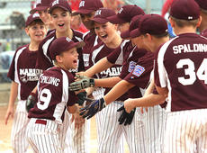 """<div class=""""source"""">Jessica Veatch</div><div class=""""image-desc"""">The Marion County 11-year-old All-Stars yell with Ethan Spalding as he is introduced at one of the games.</div><div class=""""buy-pic""""><a href=""""/photo_select/13599"""">Buy this photo</a></div>"""