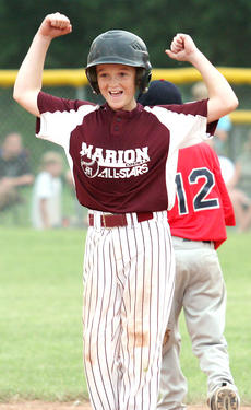 """<div class=""""source"""">Jessica Veatch</div><div class=""""image-desc"""">Jaron Morris celebrates after connecting on a double during a game in the State Tournament.</div><div class=""""buy-pic""""><a href=""""/photo_select/13597"""">Buy this photo</a></div>"""
