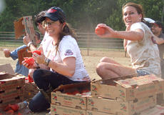 """<div class=""""source"""">Stephen Lega</div><div class=""""image-desc"""">Holly Marie Combs squeezes a tomato to soften it, as Shannen Doherty uses a box as a shield and Jenna Cook prepares to throw a few tomatoes. </div><div class=""""buy-pic""""><a href=""""http://web2.lcni5.com/cgi-bin/c2newbuyphoto.cgi?pub=015&orig=07-30-14_tomato_conflict_pic_10.jpg"""" target=""""_new"""">Buy this photo</a></div>"""
