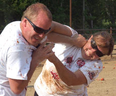 """<div class=""""source"""">Stephen Lega</div><div class=""""image-desc"""">As the fight is winding down, Joel and Laura Steele try to smear tomatoes on each other. </div><div class=""""buy-pic""""><a href=""""http://web2.lcni5.com/cgi-bin/c2newbuyphoto.cgi?pub=015&orig=07-30-14_tomato_conflict_pic_14.jpg"""" target=""""_new"""">Buy this photo</a></div>"""