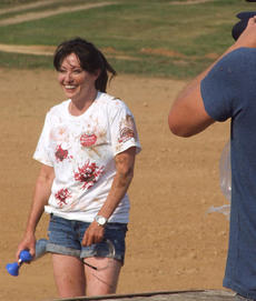 """<div class=""""source"""">Stevie Lowery</div><div class=""""image-desc"""">Shannen Doherty holds an air horn, which was used to signal the end of the fight, as a cameraman films her for a television show. </div><div class=""""buy-pic""""><a href=""""http://web2.lcni5.com/cgi-bin/c2newbuyphoto.cgi?pub=015&orig=07-30-14_tomato_conflict_pic_15.jpg"""" target=""""_new"""">Buy this photo</a></div>"""