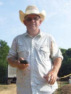 """<div class=""""source"""">Stephen Lega</div><div class=""""image-desc"""">David Neville, the manager of Popes Creek Ranch, escaped the tomato fight with minimal signs of damage. </div><div class=""""buy-pic""""><a href=""""http://web2.lcni5.com/cgi-bin/c2newbuyphoto.cgi?pub=015&orig=07-30-14_tomato_conflict_pic_16.jpg"""" target=""""_new"""">Buy this photo</a></div>"""